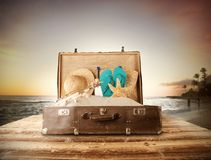 Travel concept with old suitcase on wooden planks Stock Photography