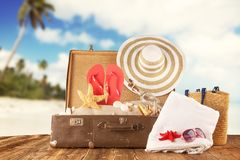 Travel concept with old suitcase on wooden planks Royalty Free Stock Photo