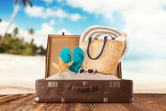 Travel concept with old suitcase on wooden planks Stock Photos