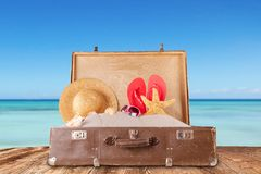 Travel concept with old suitcase on wooden planks Stock Image