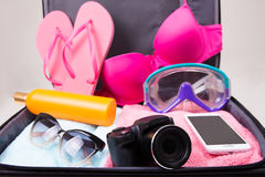 Travel concept -packed suitcase of vacation items Stock Images