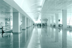 Travel concept. Passengers in the modern airport terminal waitin Stock Images