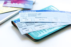 Travel concept with passport, credit cards and flight tickets on light table. Travel concept with passport, credit cards and flight tickets on light wooden table Royalty Free Stock Photography