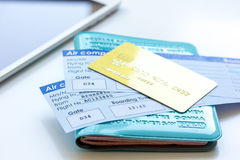 Travel concept with passport, credit cards and flight tickets on light table. Travel concept with passport, credit cards and flight tickets on light wooden table Royalty Free Stock Image