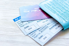 Travel concept with passport, credit cards and flight tickets on light table. Travel concept with passport, credit cards and flight tickets on light wooden table Royalty Free Stock Photos