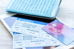 Travel concept with passport, credit cards and flight tickets on light table. Travel concept with passport, credit cards and flight tickets on light wooden table Stock Photography