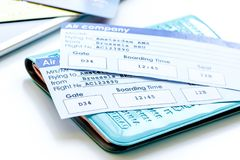 Travel concept with passport, credit cards and flight tickets on. Light wooden table background stock image