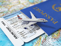 Travel concept. Passports, airline tickets and airplane. On the world map Stock Photography