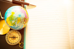 Travel concept, pen, compass, globe and empty of notebook for fo. R blog entries, you can place your text or information. Top view. Vintage filtered Stock Image