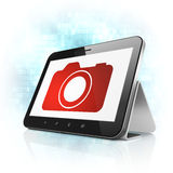 Travel concept: Photo Camera on tablet pc computer Stock Images