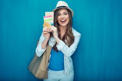 Travel concept portrait of happy woman tourist. Girl holding passport with credit card and ticket Royalty Free Stock Photos