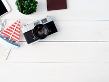 Travel concept with retro camera films, map, passport, smartphone on white wooden with copy space, Tourist essentials,. Top view travel concept with retro camera royalty free stock photos