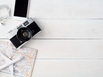 Travel concept with retro camera films, map, passport, smartphone on white wooden with copy space, Tourist essentials,. Top view travel concept with retro camera royalty free stock photography
