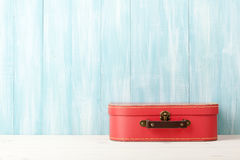 Travel concept with retro style suitcase on blue wooden background royalty free stock images