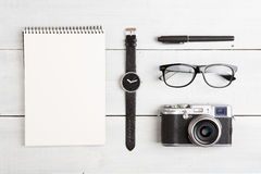 Travel concept - set of camera, notepad, watch, glasses and pen Royalty Free Stock Photography