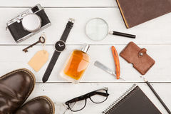travel concept - set of cool stuff with camera and other things on wooden table Royalty Free Stock Photos