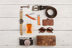 travel concept - set of cool stuff with camera and other things on wooden table Royalty Free Stock Photography