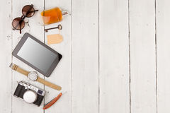 Travel concept - set of cool stuff with camera and other things on wooden table Stock Images
