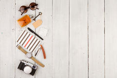 travel concept - set of cool stuff with camera and other things on wooden table Royalty Free Stock Images