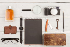 travel concept - set of cool stuff with camera and other things on wooden table Royalty Free Stock Image