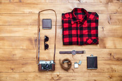 Travel concept shirt, camera, flask, watch, wallet on desk Royalty Free Stock Photo