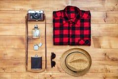Travel concept shirt, camera, hat, flask, lighter,eyeglasses, pe Royalty Free Stock Image