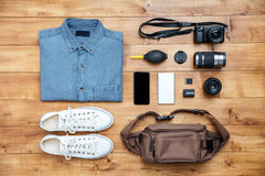 Travel concept shirt, camera, mobilephone, bag, mp3, boots,. Travel concept shirt, camera, mobilephone, bag, mp3, boots on the desk Stock Images