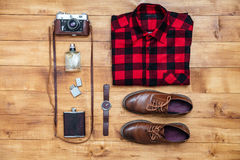 Travel concept shirt, camera, shoes, flask, lighter,watch, perfu Stock Photo