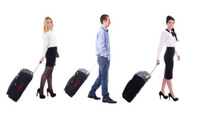 Travel concept - side view of walking stewardess and tourists wi Stock Images