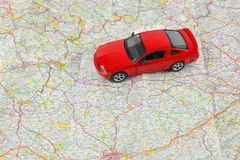 Travel concept, small car on map Royalty Free Stock Photo