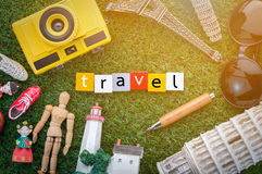 Travel concept with souvenirs around the world on green grass Stock Image