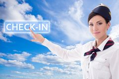 Travel concept - stewardess in uniform pointing at check-in butt Stock Photos