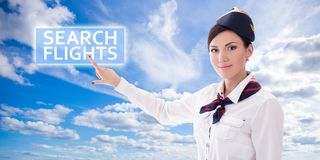 Travel concept - stewardess in uniform pointing at search flight Royalty Free Stock Image