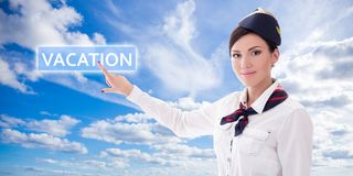 Travel concept - stewardess in uniform pointing at vacation butt Stock Photo