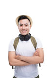 Travel concept. Studio portrait of handsome young man in hat with backpack Royalty Free Stock Photography