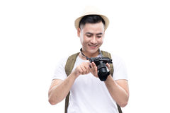 Travel concept. Studio portrait of handsome young man in hat wit Royalty Free Stock Images