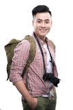 Travel concept. Studio portrait of handsome young man in hat wit Stock Images