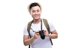 Travel concept. Studio portrait of handsome young man in hat wit Royalty Free Stock Photo
