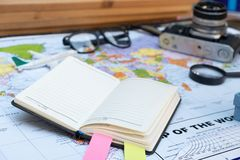 Travel concept styles with map book grasses tag. And camera royalty free stock photos