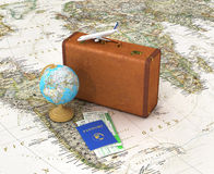 Travel concept. Suitcase for travel. Globe, passport with tickets lying on the map near the suitcase placed on the world map. 3d illustration Stock Images