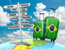 Travel concept. Suitcases and signpost what to visit in Brazil. Royalty Free Stock Photos
