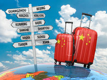Travel concept. Suitcases and signpost what to visit in China. Royalty Free Stock Photo