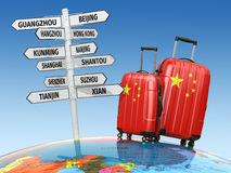 Travel concept. Suitcases and signpost what to visit in China. Stock Photos