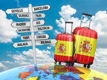 Travel concept. Suitcases and signpost what to visit in Spain Stock Images