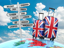 Travel concept. Suitcases and signpost what to visit in UK. Stock Photo