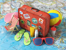 Travel concept. Summer hat, shoes, ball, sun cream, sunglass and vintage suitcase on the blurred world map. Weekend and holidays Stock Photo