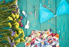 Summer women& x27;s fashion with colorful flowers, dress, swimsuit, c. Travel concept - summer women& x27;s fashion with colorful flowers, dress, swimsuit Royalty Free Stock Images