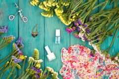 Summer women set with dress, colorful flowers, cosmetics makeup,. Travel concept - summer women set with dress, colorful flowers, cosmetics makeup, bijou and Stock Images
