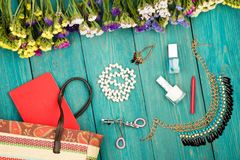 Summer women set with straw bag, colorful flowers, cosmetics mak. Travel concept - summer women set with straw bag, colorful flowers, cosmetics makeup, notepad Stock Photo