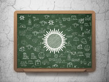 Travel concept: Sun on School Board background Stock Image